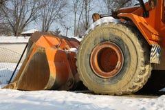Building machine and snow Stock Photo