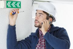 Building maintenance coordinator inspecting work. Building maintenance coordinator inspecting the work royalty free stock photo