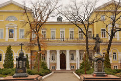 The building of male monastery. With two monuments to the facade Royalty Free Stock Photo