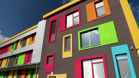 Building with many-coloured windows. New building with many-coloured windows stock video footage