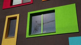 Building with many-coloured windows. New building with many-coloured windows stock footage