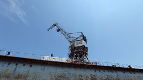 Building marine crane ship cargo on the dock at. The seaport FullHD HD stock video