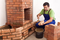 Building a masonry heater Royalty Free Stock Images