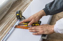 Building materials, PVC panels cut with a ruler, tape measure Royalty Free Stock Images