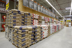 Building materials store. Stacks of cement bags and construction materials are displayed in an OBI building materials store Stock Image