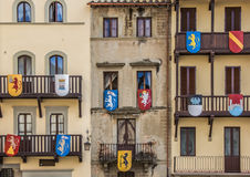 Building with medieval shields at the Piazza Grande in Arezzo Royalty Free Stock Images