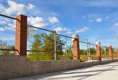 Building a Metal and Concrete, Bricks Fence with Iron Bar Framework Stock Image