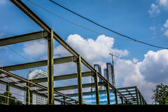 Building metal construction with sky scrapper building with blue cloud sky. Photo taken in jakarta java indonesia Stock Photo