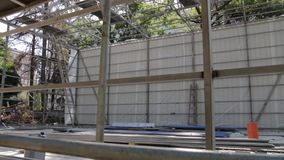 The building metal frame. On the construction site in the forest with steadicam camera movement stock video