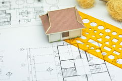 Building model. Architectural project./ Building model and drafting tools on construction plan Royalty Free Stock Images