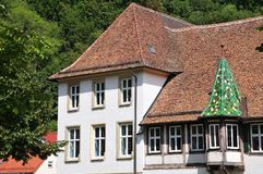 Historic building in monastery yard, Blaubeuren, Germany. Building in monastery yard of Blaubeuren, Germany, with traditional roof tiles in beavertail shape and royalty free stock images