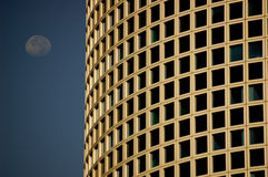 Building and moon. Corporate building and moon Stock Images