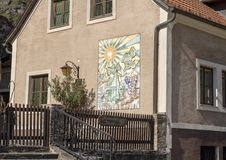 Building with mosaic next to defense tower, St. Michael`s Church, North side of the Danube, Wachau Valley in Lower Austria. Pictured is building with a mosaic royalty free stock photography