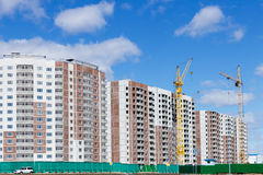 Building a multi-storey building. With a tower crane Stock Photos