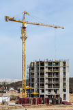 Building multi-storey houses and tall cranes. Building-industry and high-rise crane.Building multi-storey houses and tall cranes. Hoist crane and multi-storey Royalty Free Stock Image