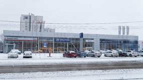 Building of multibrand car selling and service center. Ulyanovsk, Russia - December 03, 2016: Building of multibrand car selling and service center with signs of stock images