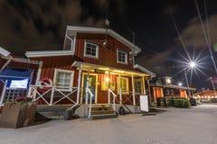 Building near marina at night with cloudy sky. Nynashamn. Sweden Stock Image