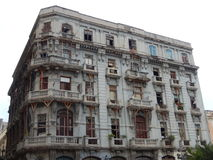 BUILDING NEAR TO COLLAPSE IN A STREET OF HAVANA, CUBA. Building near to collapse still standing vertically in Old Havana, Cuba stock image
