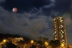 Building Neon moon eclipse Stock Photo