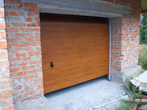 Building New Brick Garage with New Installed Garage Door. New Brick Garage with New  Garage Door Installation Royalty Free Stock Images