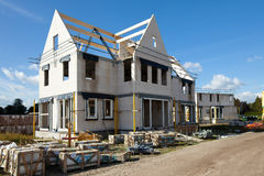 Building a new family home. Construction site building a new brick home Royalty Free Stock Photo