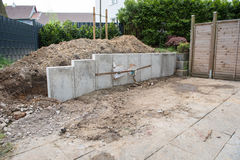 Building a new garden with stones, fences and trees Royalty Free Stock Image