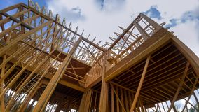 Building of New Home Construction exterior wood beam construction. Building of New Home Construction exterior wood frame and beam construction stock photography