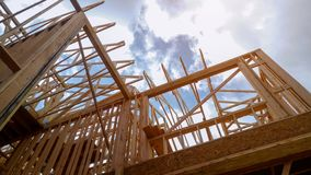 Building of New Home Construction exterior wood beam construction. Building of New Home Construction exterior wood frame and beam construction house development royalty free stock photo