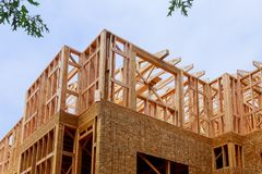 Building of New Home Construction exterior wood beam construction. New Home Construction building of exterior wood frame and beam construction, development stock photos