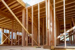 Building of New Home Construction exterior wood beam construction. Building of New Home Construction exterior wood frame and beam construction royalty free stock photos