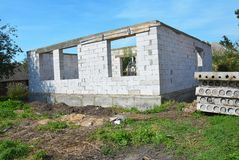 Building New House from Autoclaved Aerated Concrete Blocks with concrete lintel and Roofing Construction. Stock Photos