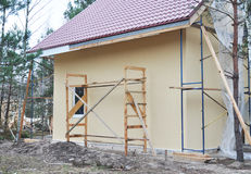 Building new House. Construction Site. Soffit and Fascia  House Installation. Royalty Free Stock Photography