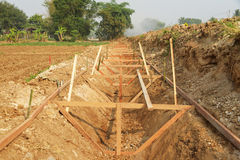 Building new irrigation canal site. Building new irrigation canal site in countryside Royalty Free Stock Photos