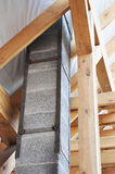 Building new modular pumice stone chimney inside of roof construction. Royalty Free Stock Image