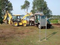 Backhoe loader and dump truck Stock Image