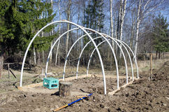 Building new plastic greenhouse hothouse construction. In farm garden royalty free stock photos