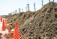 Building new road construction site cars going and lighting pole wires lay Stock Image