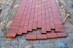 Building a new sidewalk. New red brick pavement sidewalk Royalty Free Stock Photos