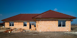 Building of new single family house. Under construction stock photography