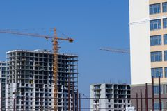 Building a new urban area. New and under construction building stock photos