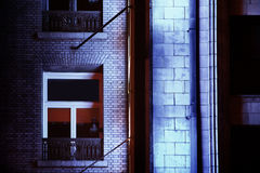 Building at night. Photo of facade of building at night with window Royalty Free Stock Image