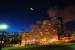 Building at Night. The Zeppelin above the building in a night time zooming around space above the downtown promenade Long Beach, CA Stock Photo