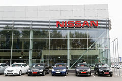 Building of Nissan car selling and service center with Nissan sign. Ulyanovsk, Russia - July 20, 2016: Building of Nissan car selling and service center with royalty free stock image