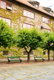 Building in Norsk Folkenmuseum. Building, benches and trees in Norsk Folkenmuseum royalty free stock photos