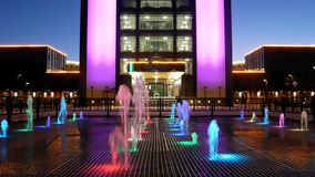 The building of the Novosibirsk University. At night with illumination, a multi-colored fountain stock video footage