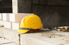 Building. Occupational safety. Yellow helmet to protect your head Royalty Free Stock Image