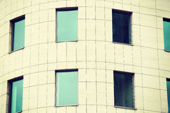 Building for offices with greeny windows. Royalty Free Stock Image
