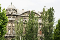 Building of old palace with big trees in center of Budapest, Hun Royalty Free Stock Photo