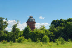 Building of the old Russian abandoned water tower resembling a chapel standing in the countryside Stock Photography