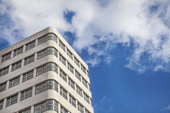 Building over blue sky. Stock Image